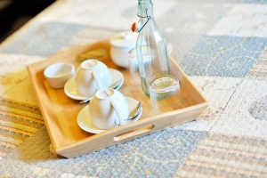 teacups on tray with water